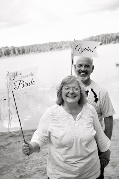 Bride & Groom with signs